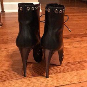 a6af0cc38b2 Alexander McQueen black leather horn heel booties